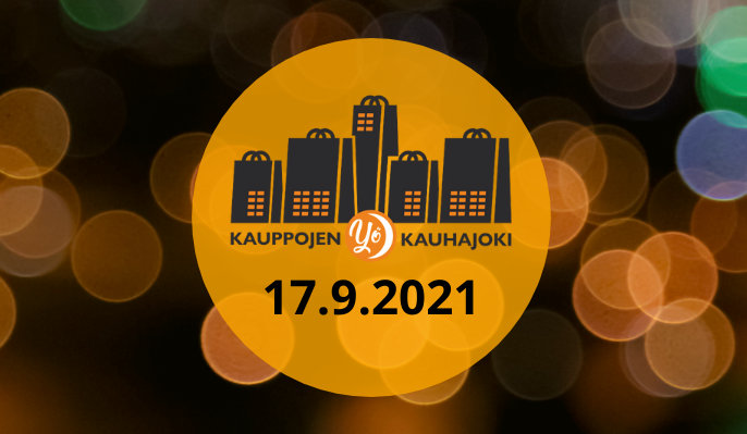 Takana näkyy kaupungin valoja ja edessä Kauppojen yö -logo.